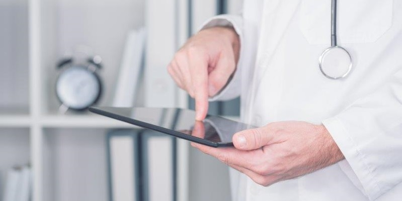 doctor checking tablet