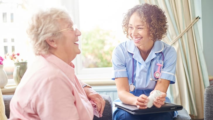 Home care provided by a smiling nurse